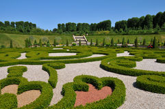 Frederiksborg Castle, Denmark. Park with royal monograms by Frederiksborg Castle, the famous Danish Castle in Hilleroed Stock Photography