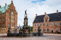 Frederiksborg Castle and Neptune Fountain Square Royalty Free Stock Images