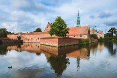 Frederiksborg castle reflected in the lake in Copenhagen, Denmark Stock Photos