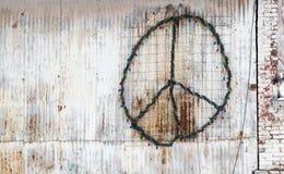 Fredtecken på sidan av en byggnad Royaltyfri Fotografi