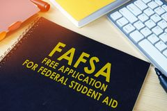 Free Application for Federal Student Aid FAFSA. Free Application for Federal Student Aid FAFSA on a table Stock Images