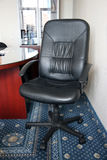 Free armchair. At office beside with a table Stock Photos