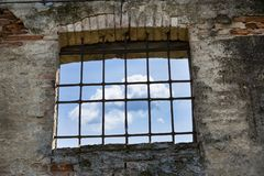 Free as a cloud behind a window with bars. royalty free stock image