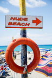 Free beach, indicator sign on wooden post with  lifesaver Royalty Free Stock Image