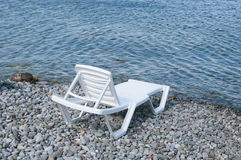 Free beach sunbed on sea shore Royalty Free Stock Photography