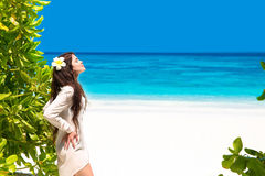 Free Beautiful Woman Enjoying Nature on tropical beach. Beauty G. Irl Outdoor. Freedom concept. Beauty Girl over Sky and blue sea. Wellness. Lifestyle. Enjoyment stock photos