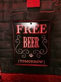 FREE BEER (tomorrow) sign stock image