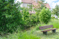 A free bench for you on a walk Stock Photography