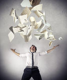 Free businessman throwing up some papers. Happy cheering businessman throwing up some piece of papers Stock Image