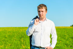 Free businessman walks   in the field Royalty Free Stock Images
