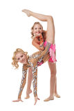Free callisthenics. Cute gymnasts performs in pair Stock Image