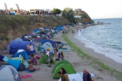 Tents pitched along the beach in Vama Veche Stock Photo