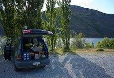 Free camping with a camper van by the dam between Alexandra and Clyde in New Zealand royalty free stock photo