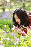 Free careless causual beauty girl smell flowers in spring park enjoy free time. Free careless causual beauty enjoy good time next to a lake ocean river beach stock images