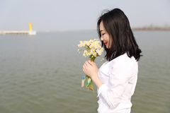 Free careless causual beauty walk by beach ocean lake river in summer spring park hold flower. Free careless causual beauty enjoy good time next to a lake ocean stock images