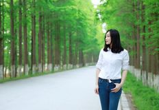 Free carelss happy woman enjoy cozy comfortable life drive a white car on a road in forest. Asian Chinese woman yoga by a lake, capped mountains on the Royalty Free Stock Photos