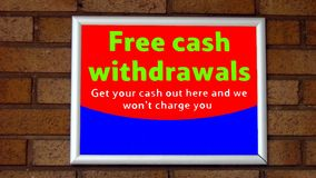 Free cash withdrawals sign. sign of a cash machine or ATM. Sign directing public to a cash machine of free cash withdrawals charge Stock Photo