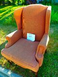 Free Chair. A free brown chair by the side of the road Royalty Free Stock Photo