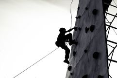 Free climber child young boy practicing on artificial boulders stock photo