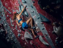 Free climber female bouldering indoors. Back view Royalty Free Stock Photos