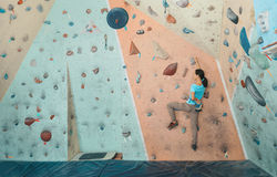 Free climber woman exercises indoor Royalty Free Stock Images