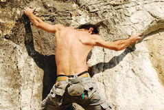 Free climbing. Male climber in a rock climbing route Stock Image