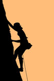 Free climbing. Downhill of free style climber after conquering the peak Stock Photo