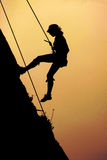 Free climbing. Downhill of free style climber after conquering the peak Royalty Free Stock Photos