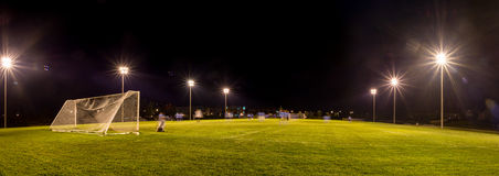 Free community public outdoor soccer field at night. Stock Images