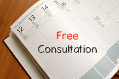 Free consultation write on notebook. Free consultation text concept write on notebook Stock Photos