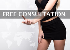 Free consultation written on a virtual screen. Internet technologies in business and tourism. woman in little black dres Royalty Free Stock Photos