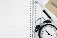 Free copy space of notebook with pen, clock and envelope. Busine Royalty Free Stock Photography