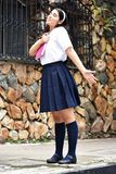 Free Cute Colombian Person Wearing Uniform With Notebook. A pretty young Colombian teen girl stock photos
