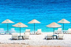 Free deck chairs by the sea Royalty Free Stock Photos