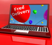 Free Delivery Balloons On Computer Showing No Charge Or Gratis T Stock Photos