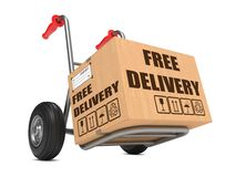 Free Delivery - Cardboard Box on Hand Truck. Stock Photo