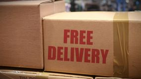 Free delivery cartons at logistics center stock video footage