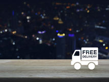 Free delivery truck icon on wooden table Stock Image