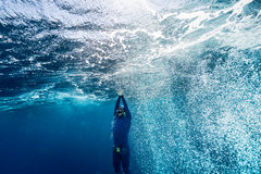 Free diver ascending from the depth Royalty Free Stock Photo