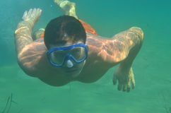 Free diver wearing goggles - underwater portrait Stock Photo