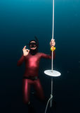 Free divers showing OK sign Royalty Free Stock Photo