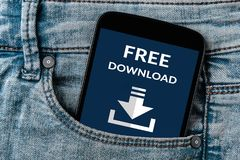 Free download concept on smartphone screen in jeans pocket. All screen content is designed by me. Flat lay stock image