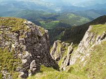 Free Fall. On the top of a cliff, In Ceahlau Mountain, Romania Royalty Free Stock Photos
