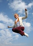 Free flying. Girl jumping high on trampoline Stock Image
