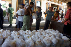 Free food aid. The poor get free food aid from the government in the city of Solo, Central Java, Indonesia royalty free stock photo