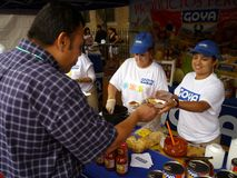 Free Food From Goya Foods. Photo of man receiving a free sample of goya food at the mount pleasant latino festival on 9/27/09.  Goya is one of the largest Royalty Free Stock Photos