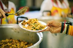 Free food for the poor and Food distribution.  stock image