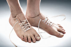 Free foot. Photo manipulation about the free and comfortable concept royalty free stock photo