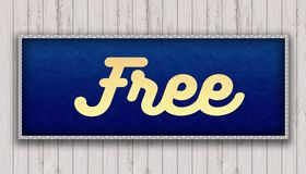 FREE handwritten on blue leather pattern painting hanging on wooden wall. Illustration Stock Photo