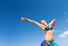Free happy tropical woman. Tropical woman happy and carefree with clear blue sky on beach with sarong Royalty Free Stock Image